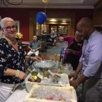 Staff assisting residents with the specialty drinks, wine, beer, and a variety of non-alcoholic beverages