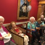 Residents enjoying the music and southern cuisine appetizers.
