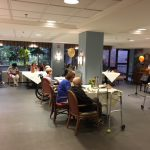 Residents in The Springs enjoying the country music social event.