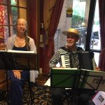 Talented soprano Adrienne Fortini and accordionist Paul Aebersold setting the mood for the Italian social hour with popular Italian songs.