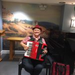 Accordionist Sylvia Eberle entertaining our residents in The Springs.