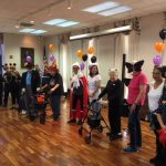 Parade of costumes by the residents and associates