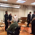 More veterans approaching the musicians to thanked them for a wonderful Salute to Veterans concert