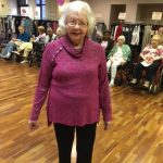 Resident Pat Dowd wearing a beautiful shawl collar red violet sweater
