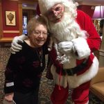 Santa meeting one of the residents