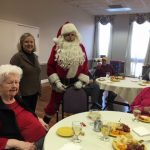 Santa greeting residents and family members