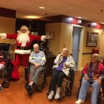 Enjoying Santa's visit with The Springs residents