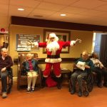 Santa socializing with the residents during the sing-along