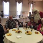 Santa socializing with the Town Center residents during Mix and Mingle