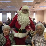 More of Santa Clause socializing with the residents