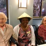 Happy smiles by residents and associate during social hour