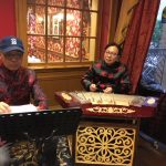 Duke Tang and his friend tuning up their Chinese instruments