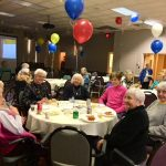 Residents socializing with their neighbors and enjoying the refreshments