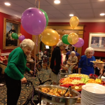 Dining Services director is helping out residents with delicious appetizers